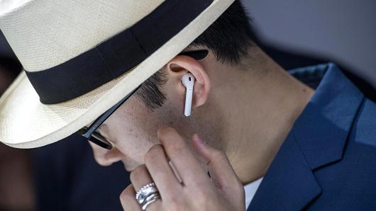 An attendee wears the Apple AirPod wireless headphones during an event in San Francisco, California, on Wednesday, Sept. 7, 2016.